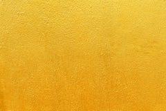 Goldener Beschaffenheitshintergrund Lizenzfreies Stockfoto
