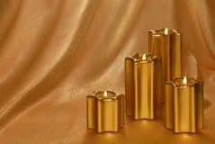 Goldener candlelit Hintergrund stockfoto