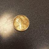Goldener Cent Lizenzfreies Stockfoto