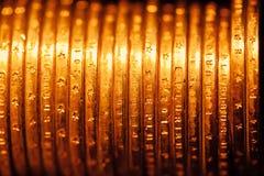 Goldener Dollar prägt Hintergrund Stockbild