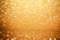 Goldener Funkeln bokeh Hintergrund Glänzender Feiertags-Hintergrund Lizenzfreie Stockfotografie