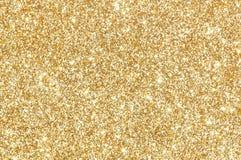 Goldener Funkelnbeschaffenheitshintergrund Stockfotografie