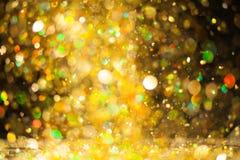 Goldener Funkelnhintergrund Stockfotos