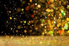 Goldener Funkelnhintergrund Stockbild