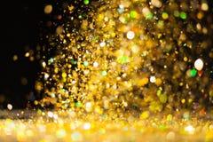 Goldener Funkelnhintergrund Lizenzfreies Stockfoto