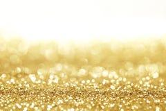 Goldener Funkelnhintergrund Lizenzfreie Stockfotos
