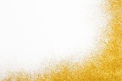 Goldener Funkelnsand-Beschaffenheitsrahmen auf weißem, abstraktem Hintergrund Lizenzfreie Stockfotos