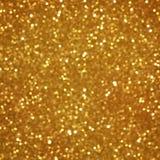 Goldener Funkelnweihnachtshintergrund Stockbild
