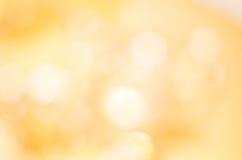 Goldener gelber Bokeh Hintergrund Stockbilder