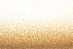 Goldener gelber Funkelnhintergrund lizenzfreie stockfotos