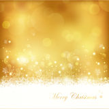 Goldener glühender Weihnachtshintergrund Stockfotografie