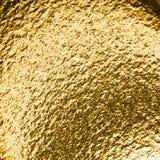 Goldener grungy Hintergrund Stockfoto