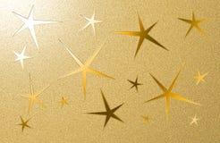 Goldener grungy Hintergrund mit fünf gezeigten Sternen Stockfotografie