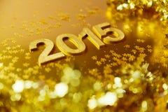 Goldener Hintergrund des neuen Jahres 2015 Flache Schärfentiefe Stockfotos