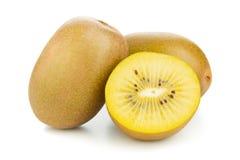 Goldener Kiwifruit-/kiwischnitt und ganz Stockfotos