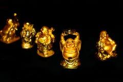 Goldener lachender Buddha stockbild