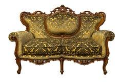 Goldener Luxuslehnsessel Sofa der Weinlese lokalisiert auf Weiß Lizenzfreies Stockfoto