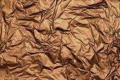 Goldener metallischer Folienbeschaffenheitshintergrund stockbild
