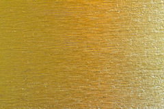Goldener Metallmessing verkratzte Hintergrundbeschaffenheit Stockfotos