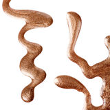 Goldener Nagellack floß Stockfoto