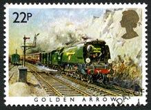 Goldener Pfeil-Zug-BRITISCHE Briefmarke Stockfoto