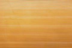 Goldener Plastikhintergrund Stockbild