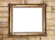 Goldener Rahmen auf Ziegelsteinsteinwandhintergrund Stockbild