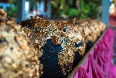 Goldener runder Stein Stockfotografie
