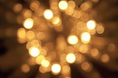 Goldener schöner abstrakter bokeh Hintergrund Stockfotografie