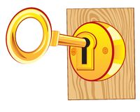Goldener Schlüssel im Verschluss Stockfotografie