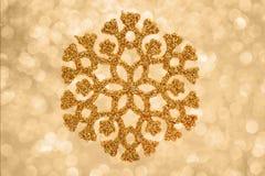Goldener Schneeflockenhintergrund Stockfotografie