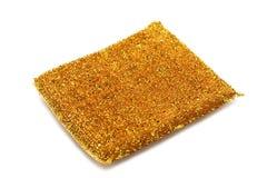 Goldener Schwamm für Reinigungsteller Lizenzfreies Stockbild