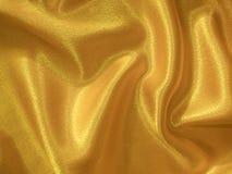 Goldener silk Hintergrund Stockbilder