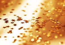 Goldener Sternhintergrund Lizenzfreie Stockfotos