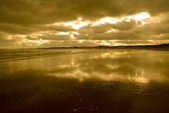 Goldener Strand Stockfoto