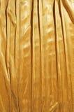 Goldener Tuchhintergrund Stockfoto