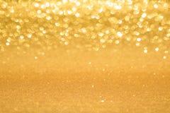Goldener unscharfer Hintergrund lizenzfreies stockbild