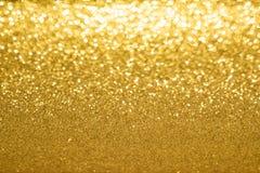 Goldener unscharfer Hintergrund lizenzfreie stockfotografie