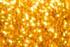 Goldener verwischender Hintergrund Stockbild