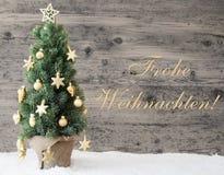 Goldener verzierter Baum, Frohe Weihnachten bedeutet frohe Weihnachten Stockfotografie