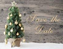 Goldener verzierter Weihnachtsbaum, Text-Abwehr das Datum Lizenzfreie Stockfotos