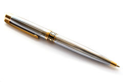 Goldener vollziehendstift auf Weiß Lizenzfreie Stockbilder