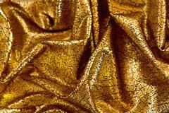Goldener Weihnachtsstoff mit Sprüngen Stockfoto