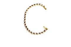 Goldenes Armband mit Edelstein lizenzfreie stockfotos