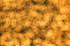 Goldenes bokeh als Hintergrund Stockfoto