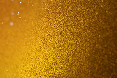 Goldenes Bokeh-Funkeln in der Neigungs-Verschiebung Lizenzfreie Stockfotografie