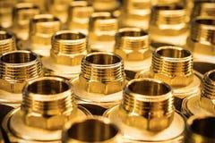 Goldenes Braun der gesundheitlichen Adapter-Installationen Lizenzfreies Stockbild