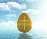 Goldenes Ei mit Kreuz stockfoto