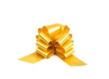 Goldenes Farbband des Geschenks getrennt auf Weiß Stockfotos