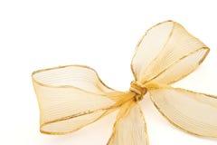 Goldenes Farbband und Bogen des Geschenks Stockbild